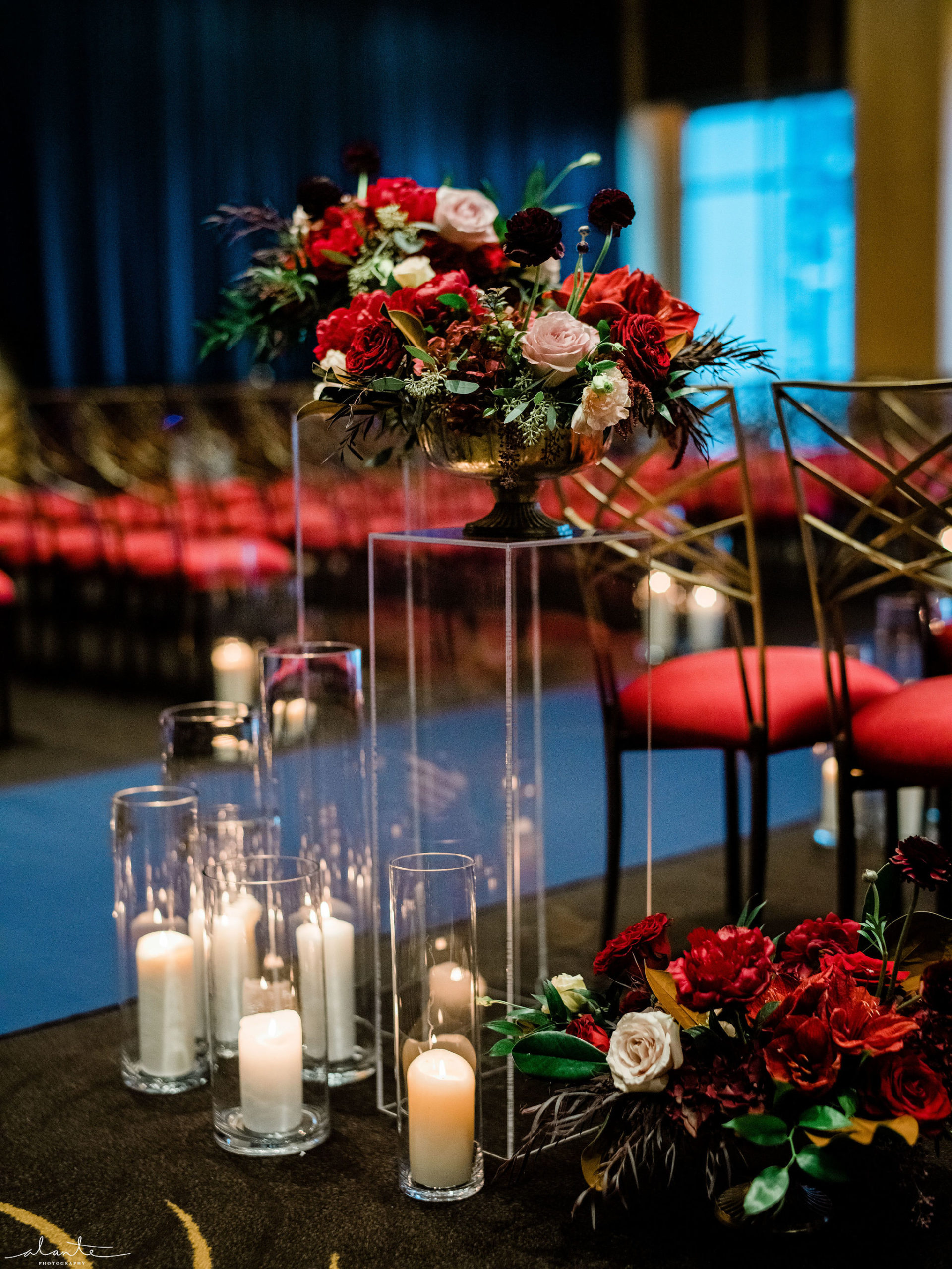 Red winter wedding aisle entrance with red winter floral and lots of candlelight. | Flora Nova Design Seattle