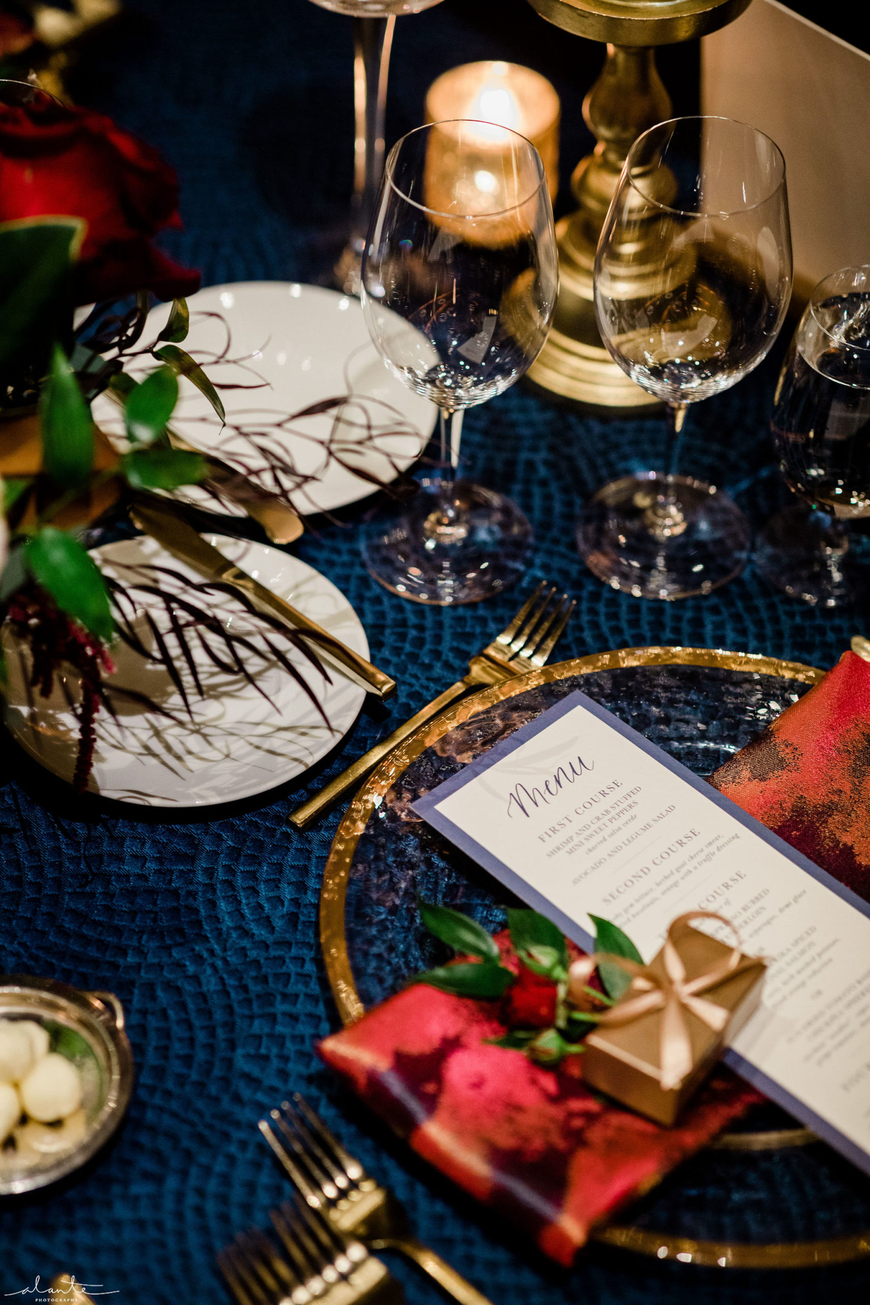 Winter wedding place setting details like a gold wrapped chocolate and red rose at each place setting delight every guest.