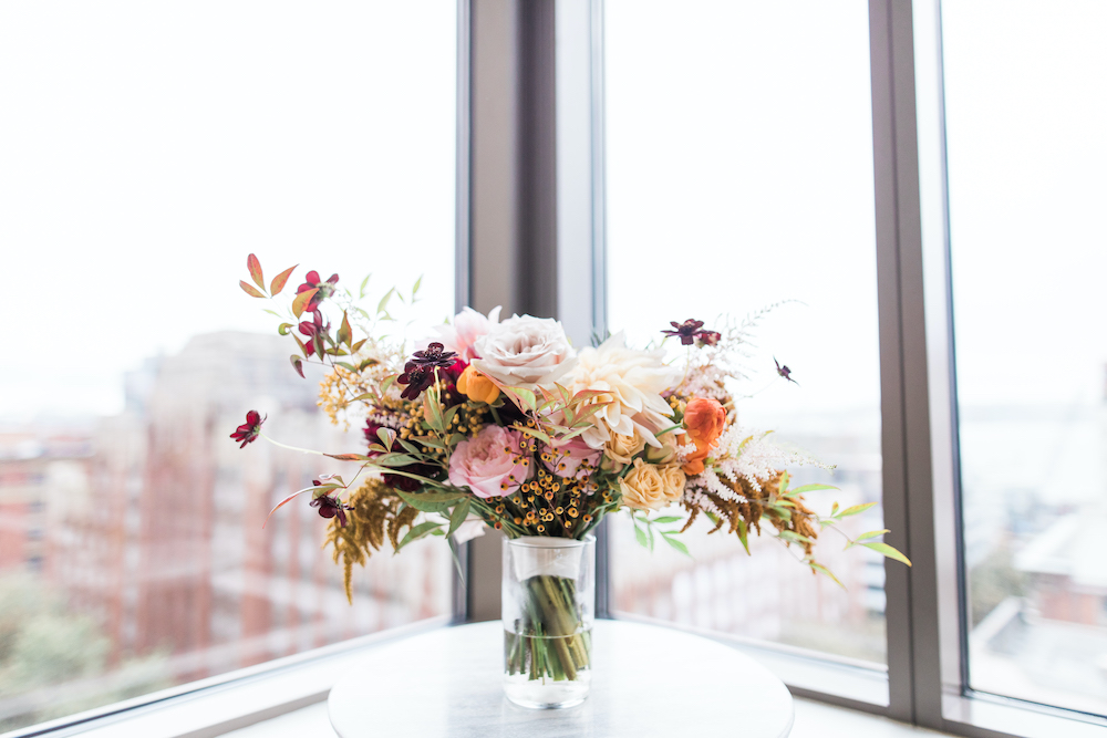 Organic garden style bridal bouquet with dahlias, roses, berries, fall foliage