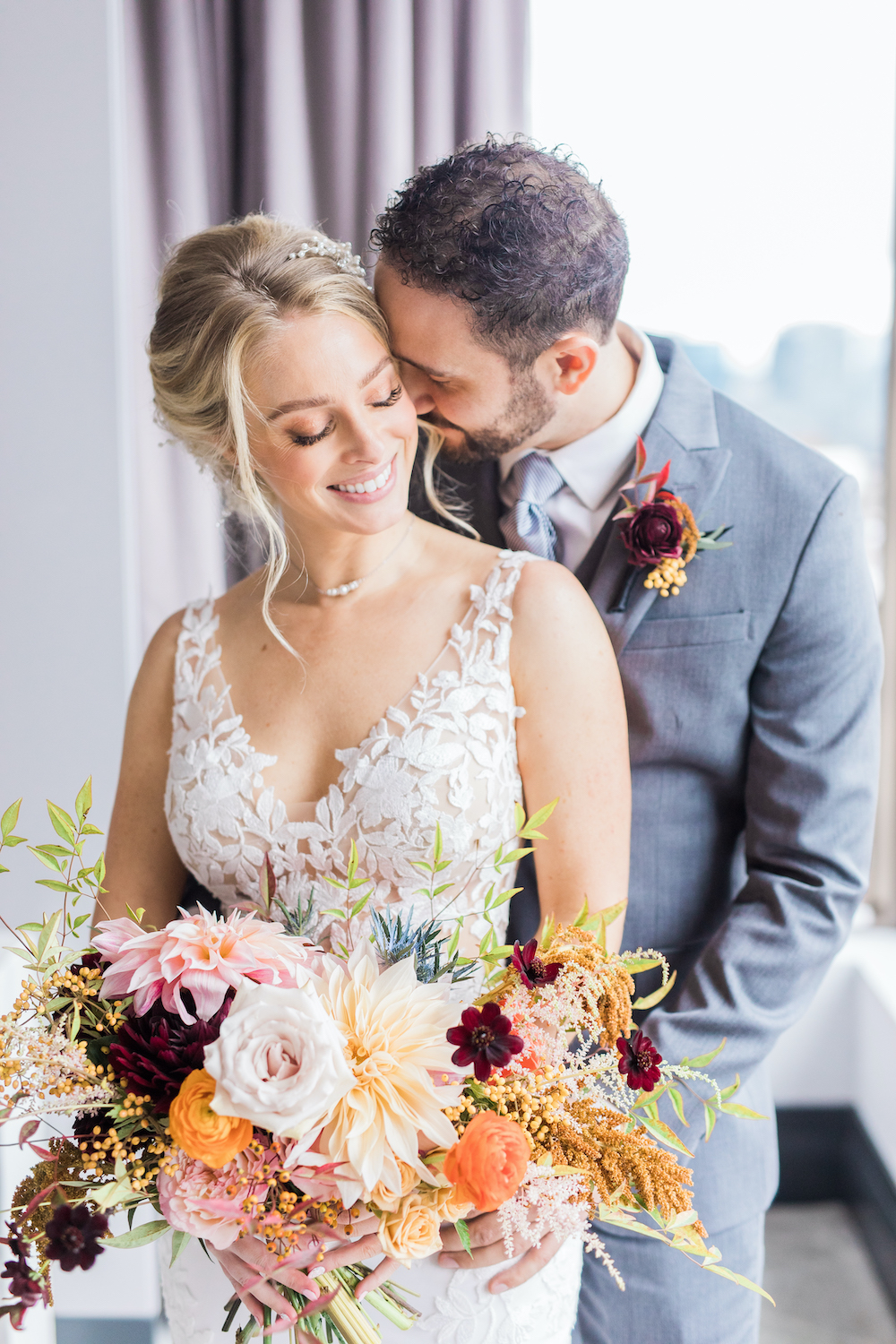 Bride and groom and fall bridal bouquet