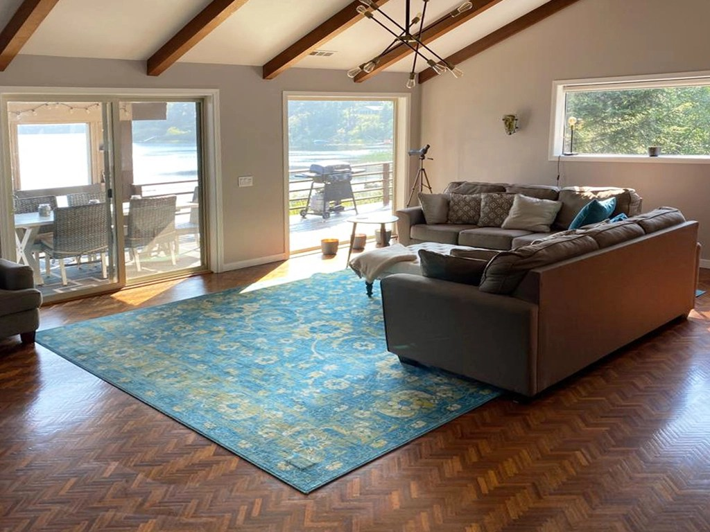 Living room with large windows overlooking lake
