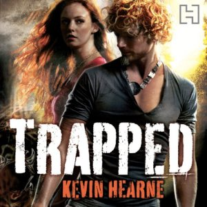audiobook cover for Trapped by Kevin Hearne narrated by Christopher Ragland