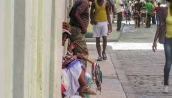 Image result for gentleman walking quickly away down busy havana street