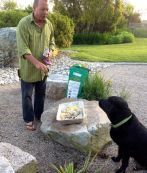 Chris's dog helped dig the clams, now he seems to be claiming some.