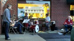 The Free Range Cats perform at the Coldwell Banker Upton-Massmont Realtor