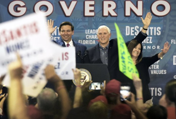 Florida Republican gubernatorial candidate Ron DeSantis waves