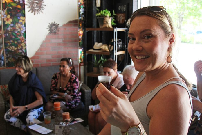 Kami Kreaps tasting Tinto coffee during the tour stop at Salento Coffee