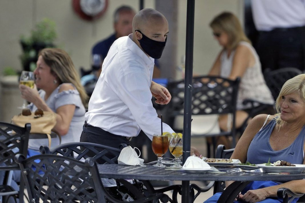 Florida takes a hesitant step toward reopening amid outbreak