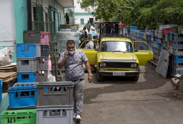 Economy tanking, Cuba launches some long-delayed reforms