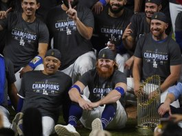 Dodgers win title, lose Turner to COVID-19