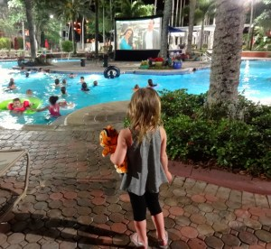 A Little Girl Watching the Saturday Night Dive In Movie at the Main Pool