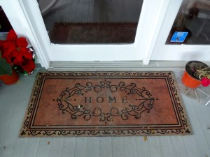 Welcome mat at the front door of River Lily Inn