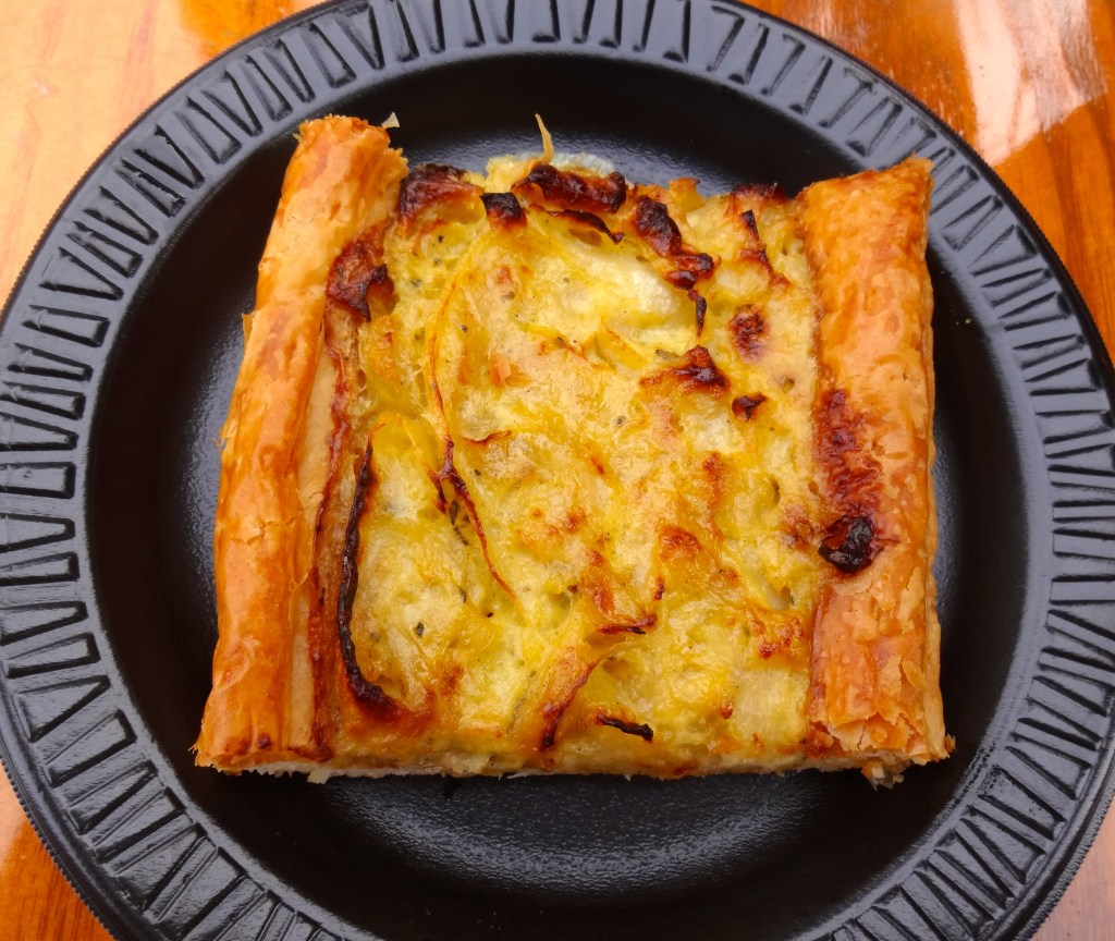 Tarte a l'Onion Alsacienne Alsatian Onion Tart with Sauteed Onions, Fresh Thyme and Rosemary on a Flaky Puff Pastry Crust