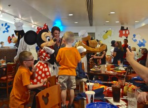 Disney Characters Visiting Tables at Chef Mickey's in the Contemporary Resort