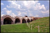 This view shows the western bastion from inside the fort. The cannon emplaced on the bastion is a 15-inch Rodman, similar to a weapon emplaced there in 1868. In the foreground are more casemates, modified when the Endicott period Battery Pensacola was installed within the walls of Fort Pickens.