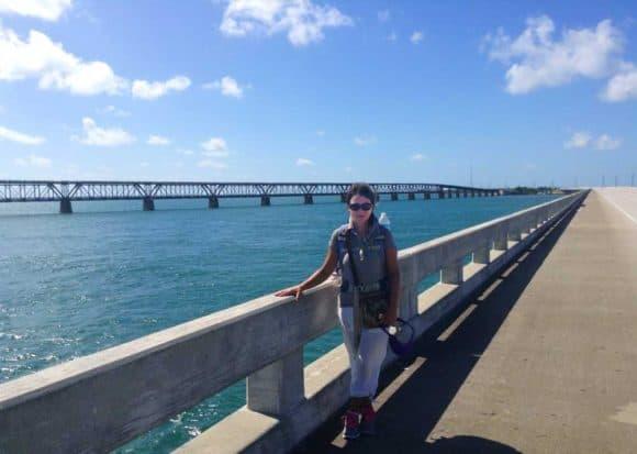 Tamara Scharf on the Bahia Honda Bridge with the Old Bahia Honda Bridge in background. Photo courtesy Tamara Scharf.