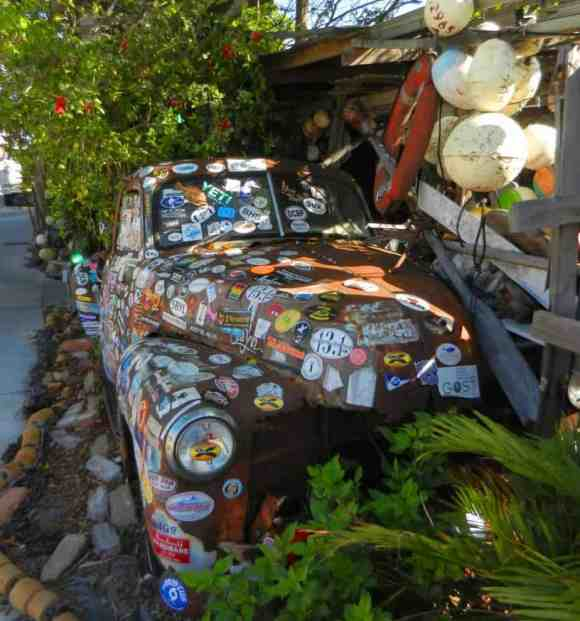 B.O.'s Fish Wagon is an open-air assemblage of drift wood, recycled sheets of tin and a 1950s Chevy truck apparently held together by bumper stickers.