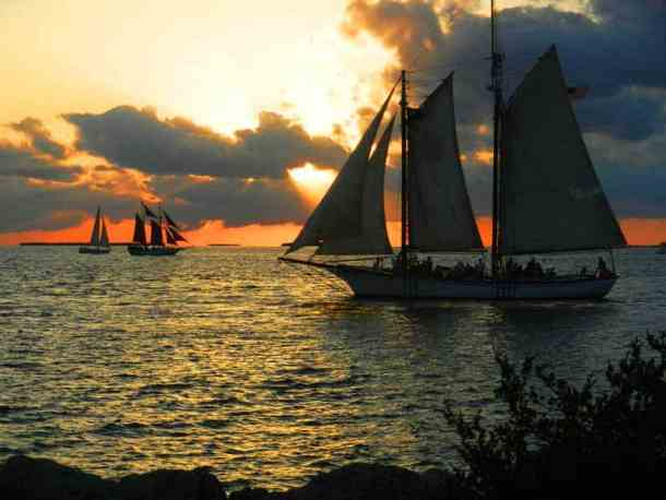 Sunset cruises sail by Fort Zachary Taylor.