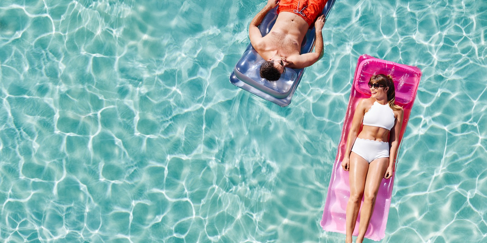 couple laying out in the pool