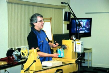 Alan Leland telling what he does.JPG