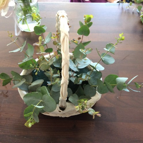 White basket with eucalyptus