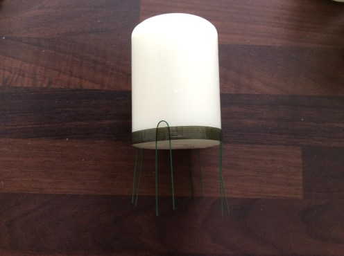 Candle with wire pins