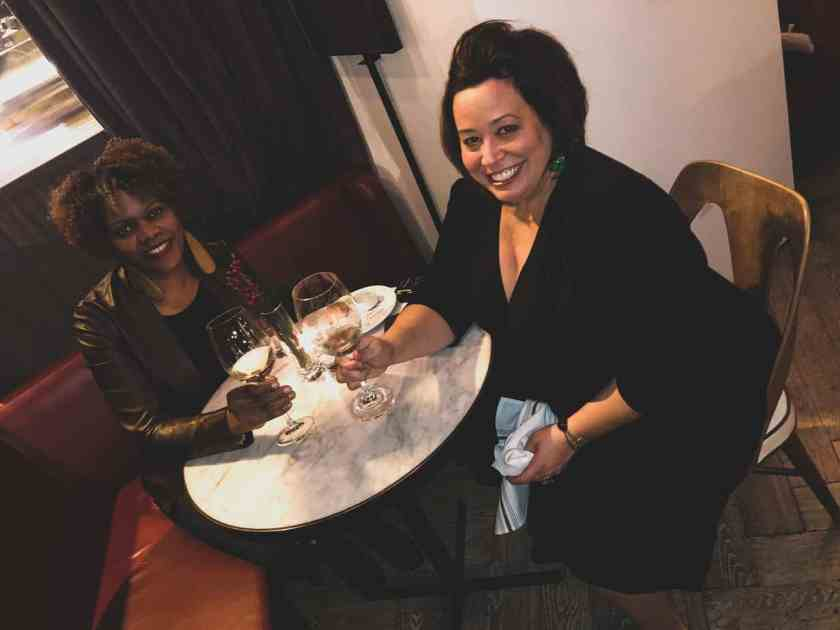 Two women enjoying wine at Cafey Robey restaurant
