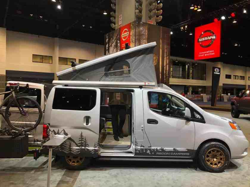 Gray Camper van with woman standing inside