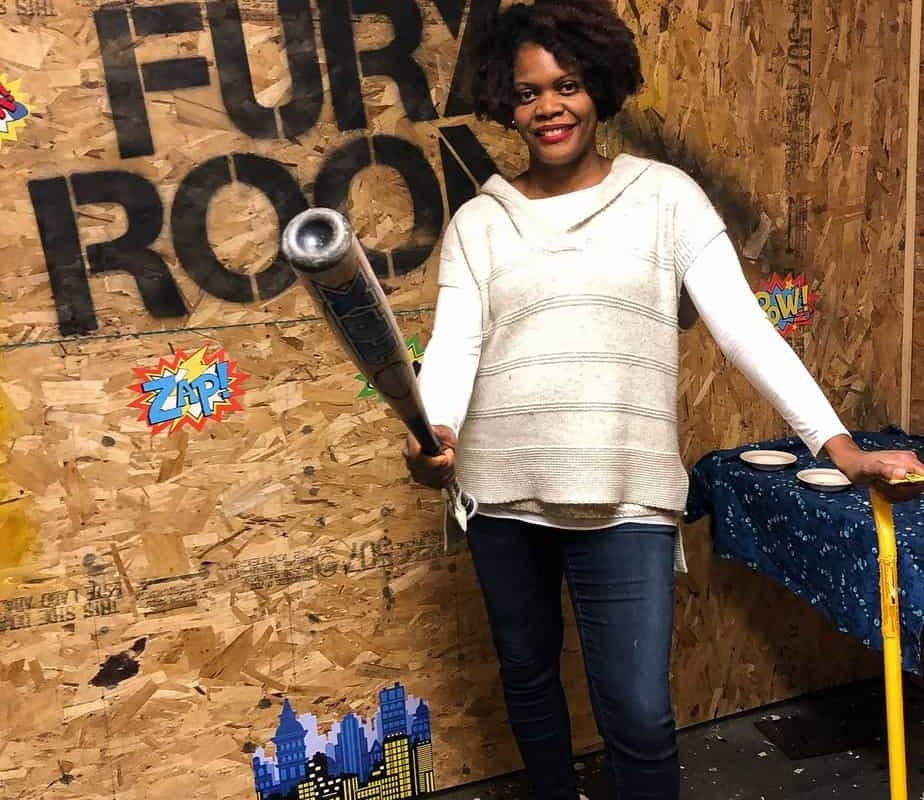 Fury Room Chicago; woman holding a bat