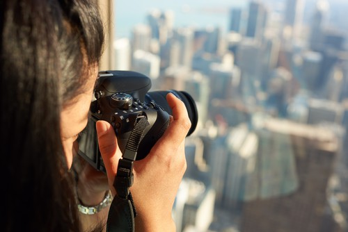 Woman taking picture of Chicago Skyline