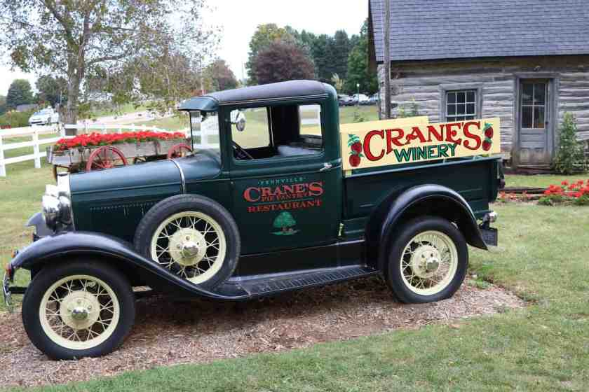 Circa 1920's green truck with Crane's Restaurant written on the side