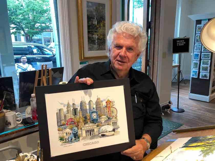 Man holding up an art print