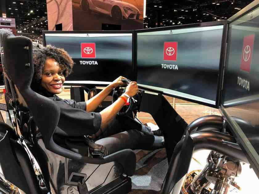 woman sitting in Toyota vehicle simulator at the Chicago Auto Show