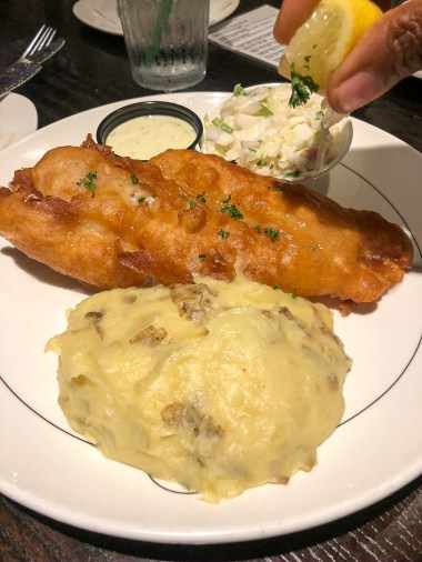 Fried fish and mashed potatoes at Grindstone Public House in Noblesville, Indiana