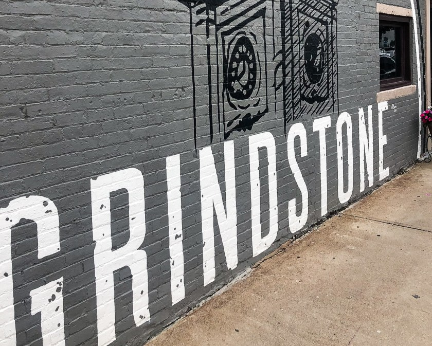 Mural that reads Grindstone on the exterior of a restaurant in Noblesville, Indiana