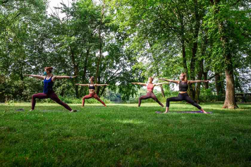 women doing yoga at The Forge Outdoor park
