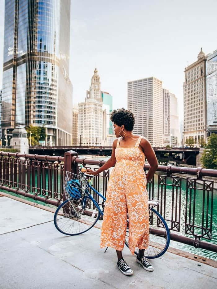 Woman standing next to bike