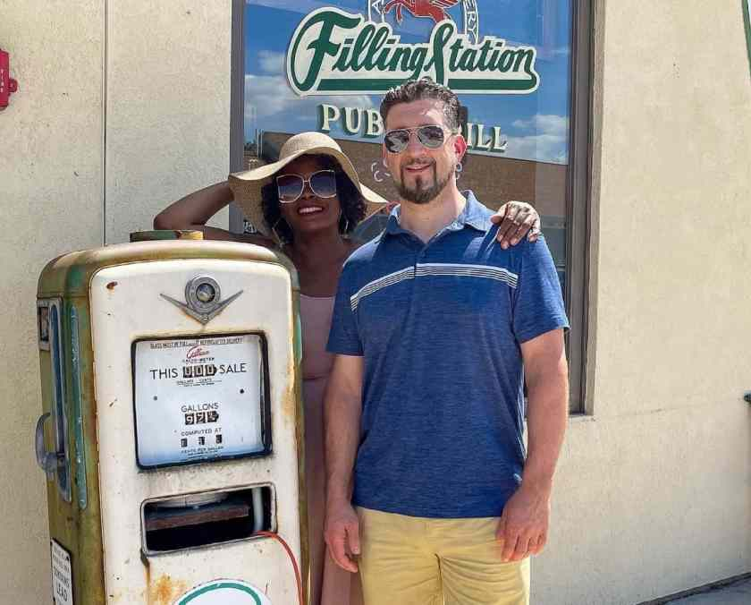 Man and woman standing outside Filling Station restaurant in St. Charles