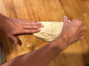 Homemade pizza dough kneading