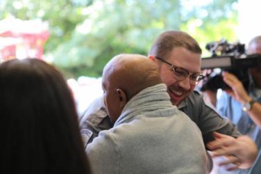 Mr. Bryson hugs 1st Responder Paramedic, Logan Rogers