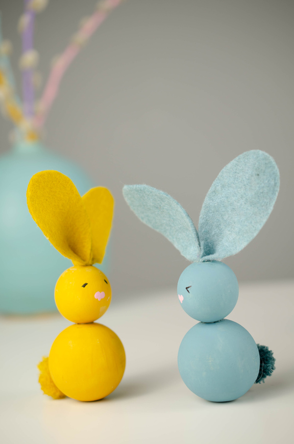 Closeup of two wooden bead bunnies