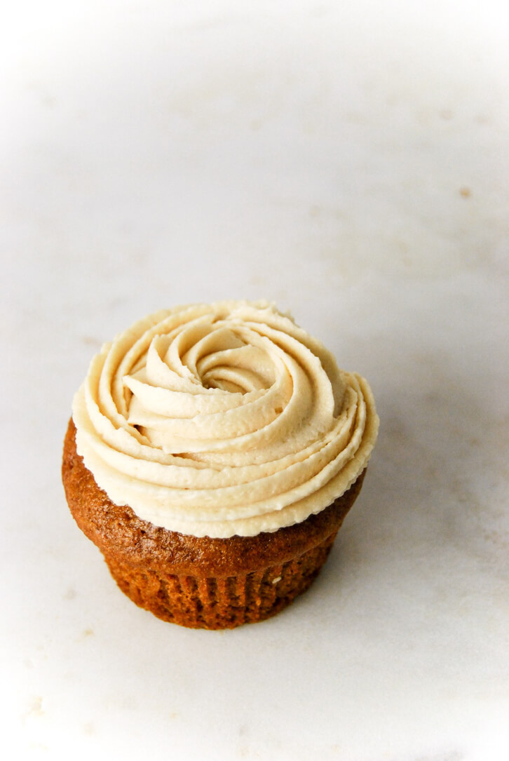 A pumpkin apple cupcake with a swirl of brown sugar buttercream