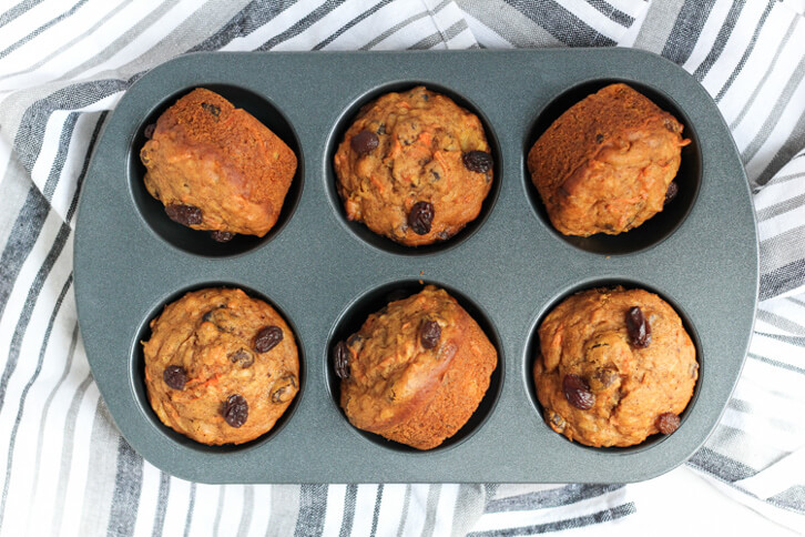 A muffin tin full of pumpkin morning glory muffins