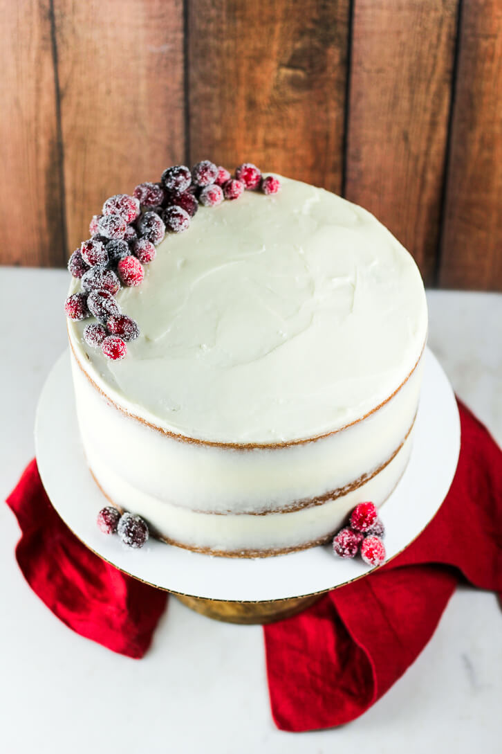 Three layer cranberry apple cake with cream cheese frosting