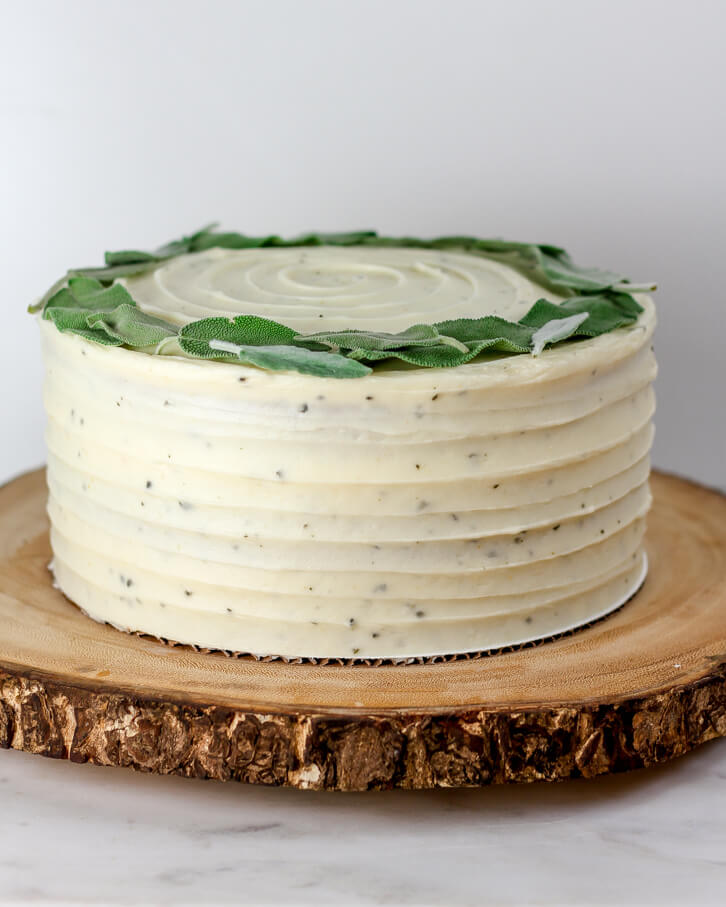 Sweet potato layer cake with brown butter sage frosting and a crown of fresh sage leaves