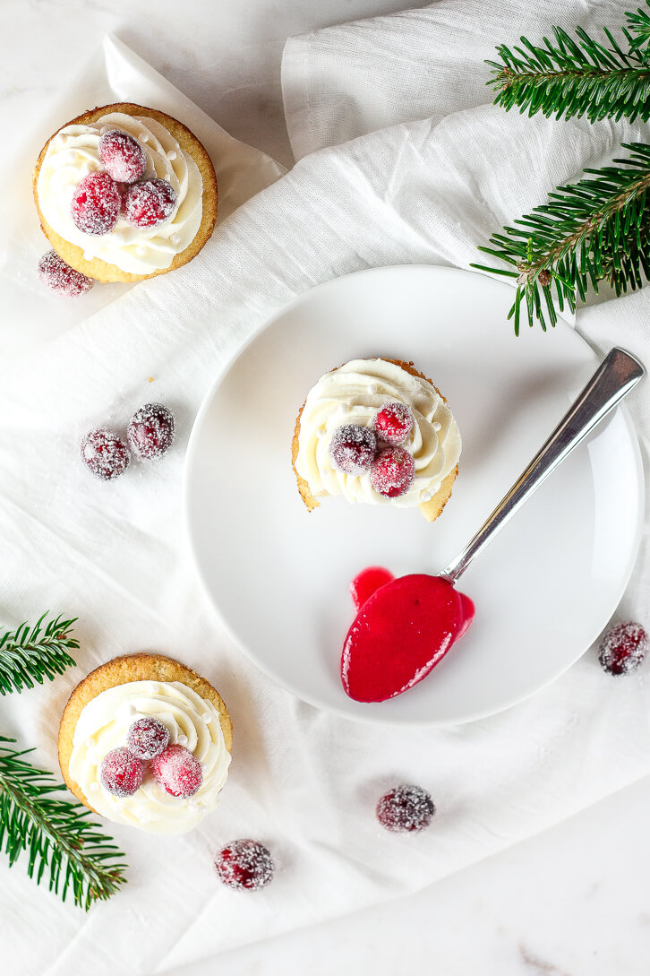 White chocolate cupcakes filled with cranberry curd