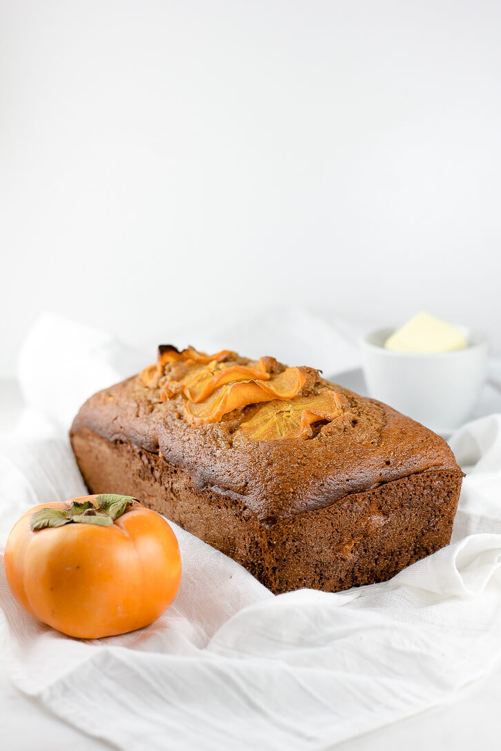 A loaf of fresh-baked persimmon bread - Flour Covered Apron