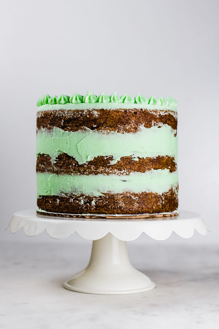 This chocolate mint brownie cake has three layers of rich brownies and a semi-naked finish of pale green mint buttercream