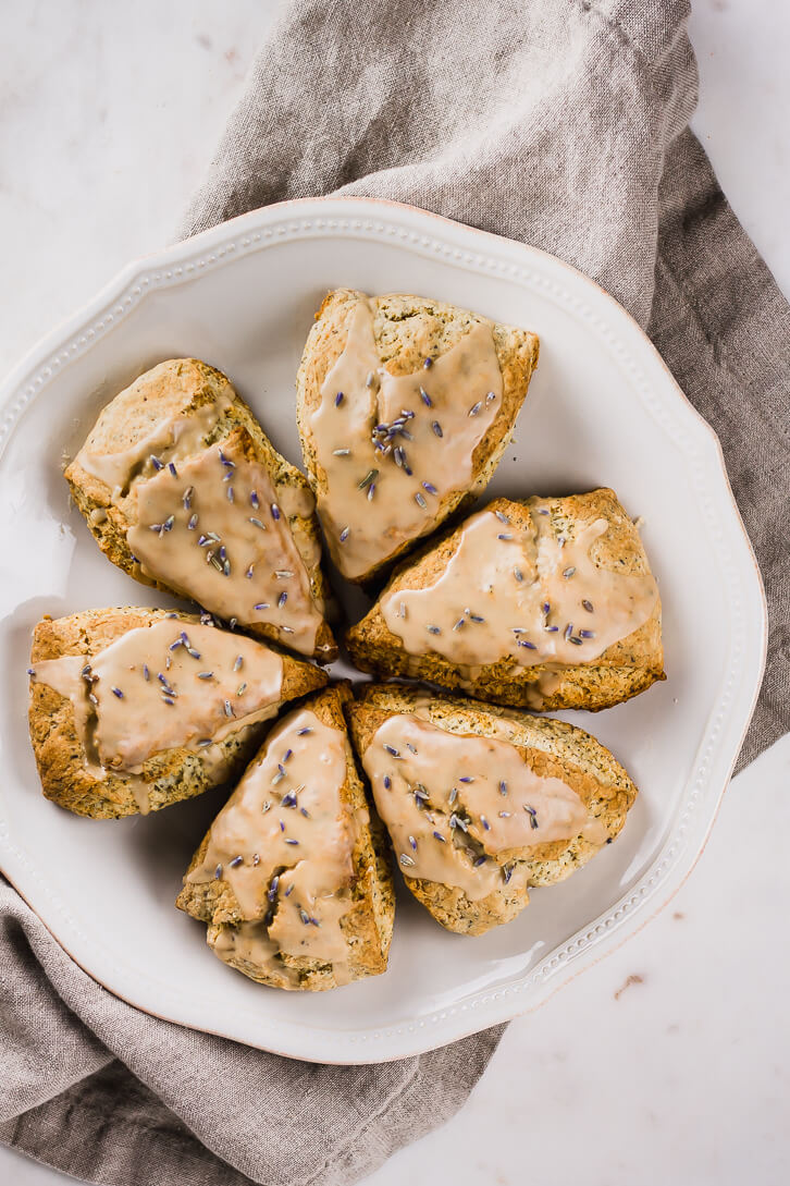 A plate of Earl Grey scones iced with a lavender and Earl Grey glaze