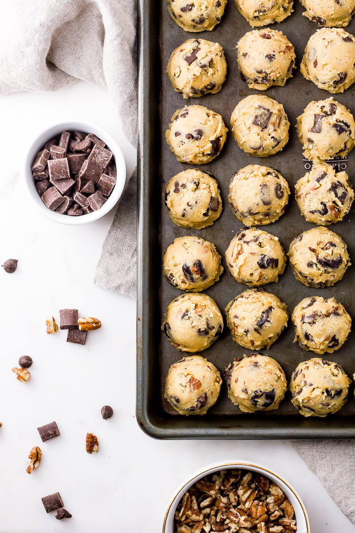 The cookie dough for these Cherry Chocolate Chip Pecan Cookies is filled with dried cherries, chocolate chunks, and chopped pecans